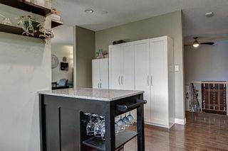 Photo 11: 128 Cedarpark Green SW in Calgary: Cedarbrae Detached for sale : MLS®# A1109711