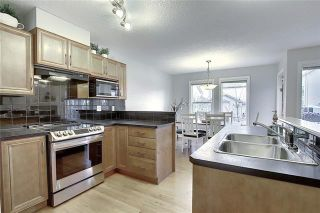 Photo 4: 33 ROYAL CREST View NW in Calgary: Royal Oak Semi Detached for sale : MLS®# C4299689