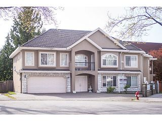 Photo 1: 12321 91A Avenue in Surrey: Queen Mary Park Surrey House for sale : MLS®# F1410080