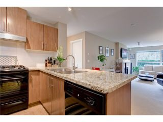 Photo 1: 120 700 Klahanie Drive in Port Moody: Port Moody Centre Condo for sale : MLS®# V923420