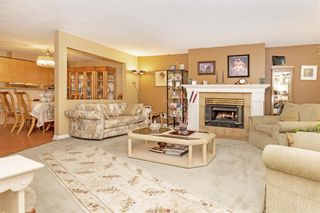 "Photo 3: 105 7837 120A Street in Surrey: West Newton Townhouse for sale in ""Berkshyre Gardens"" : MLS®# R2371000"