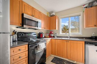 Photo 4: 38 Eversyde Common SW in Calgary: Evergreen Row/Townhouse for sale : MLS®# A1144628