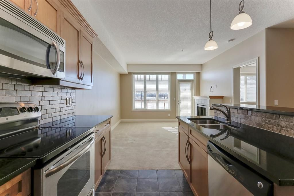 Main Photo: 2341 2330 FISH CREEK Boulevard SW in Calgary: Evergreen Apartment for sale : MLS®# A1064057