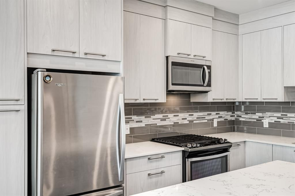 Photo 4: Photos: 125 Redstone Crescent NE in Calgary: Redstone Row/Townhouse for sale : MLS®# A1124721