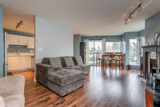 """Photo 1: 204 20277 53 Avenue in Langley: Langley City Condo for sale in """"The Metro II"""" : MLS®# R2347214"""