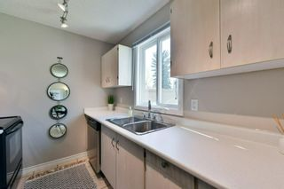Photo 15: 1301 829 Coach Bluff Crescent in Calgary: Coach Hill Row/Townhouse for sale : MLS®# A1094909