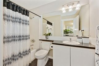 Photo 17: 1004 1997 Sirocco Drive SW in Calgary: Signal Hill Row/Townhouse for sale : MLS®# A1132991