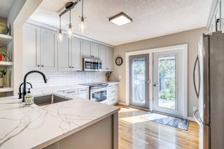 Photo 7: 202 19 Street NW in Calgary: West Hillhurst Semi Detached for sale : MLS®# A1129598