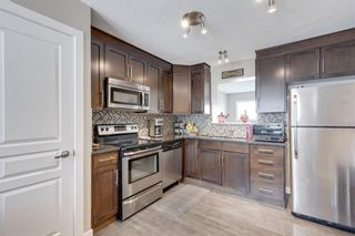 Photo 3: 39 Panatella Road NW in Calgary: Panorama Hills Row/Townhouse for sale : MLS®# A1124667
