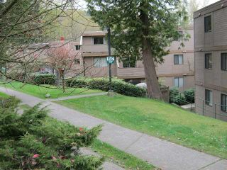 """Photo 1: 101 9147 SATURNA Drive in Burnaby: Simon Fraser Hills Townhouse for sale in """"MOUNTAINWOOD"""" (Burnaby North)  : MLS®# V944313"""