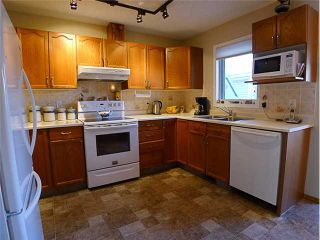 Photo 4: 1409 1 Street NE in Calgary: Crescent Heights Townhouse for sale : MLS®# C3648539