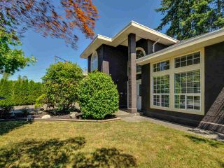 "Photo 1: 5812 185A Street in Surrey: Cloverdale BC House for sale in ""Cloverdale Hilltop"" (Cloverdale)  : MLS®# R2335126"