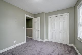 Photo 32: 312 BRIDLEWOOD Lane SW in Calgary: Bridlewood Row/Townhouse for sale : MLS®# A1046866
