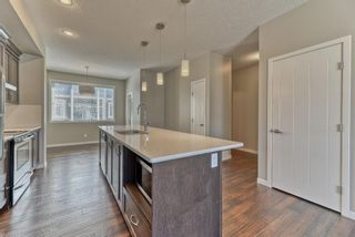Photo 6: 539 Panatella Walk NW in Calgary: Panorama Hills Row/Townhouse for sale : MLS®# A1125854