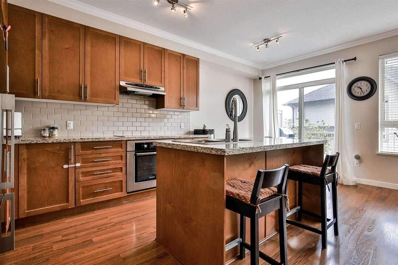 """Main Photo: 111 2738 158 Street in Surrey: Grandview Surrey Townhouse for sale in """"Cathedral Grove by Polygon"""" (South Surrey White Rock)  : MLS®# R2452758"""