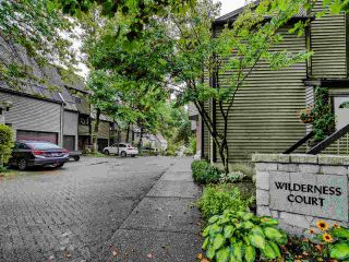 """Photo 1: 8551 WILDERNESS Court in Burnaby: Forest Hills BN Townhouse for sale in """"Simon Fraser Village"""" (Burnaby North)  : MLS®# R2490108"""