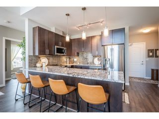 """Photo 2: 303 6490 194 Street in Surrey: Cloverdale BC Condo for sale in """"WATERSTONE"""" (Cloverdale)  : MLS®# R2489141"""