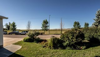 Photo 4: 314 SLADE Drive: Nanton Detached for sale : MLS®# A1032751