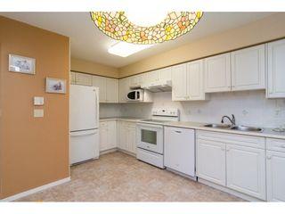 "Photo 11: 106 13860 70 Avenue in Surrey: East Newton Condo for sale in ""Chelsea Gardens"" : MLS®# R2243346"