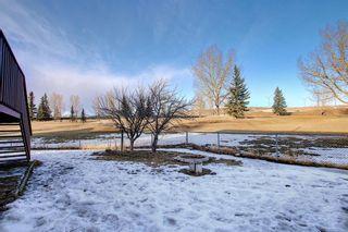 Photo 47: 39 Riverview Close: Cochrane Detached for sale : MLS®# A1079358