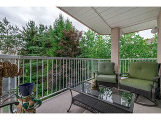 """Photo 20: 208 5375 205 Street in Langley: Langley City Condo for sale in """"GLENMONT PARK"""" : MLS®# R2295267"""