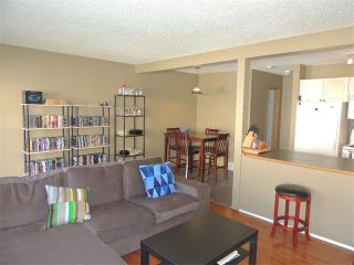 Photo 9: 37 MILLVIEW Green SW in Calgary: Millrise House for sale : MLS®# C4015611