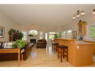 Photo 5: 134 GLENEAGLES View: Cochrane House for sale : MLS®# C4018773