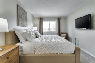 Photo 27: 84 Coach Side Terrace SW in Calgary: Coach Hill Semi Detached for sale : MLS®# A1077504