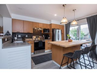 """Photo 13: 29 4401 BLAUSON Boulevard in Abbotsford: Abbotsford East Townhouse for sale in """"The Sage"""" : MLS®# R2621027"""