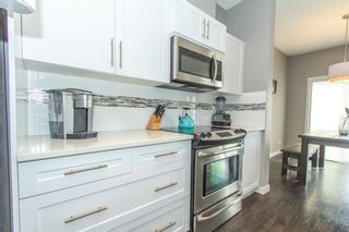 Photo 4: 2202 881 SAGE VALLEY Boulevard NW in Calgary: Sage Hill Row/Townhouse for sale : MLS®# A1029122