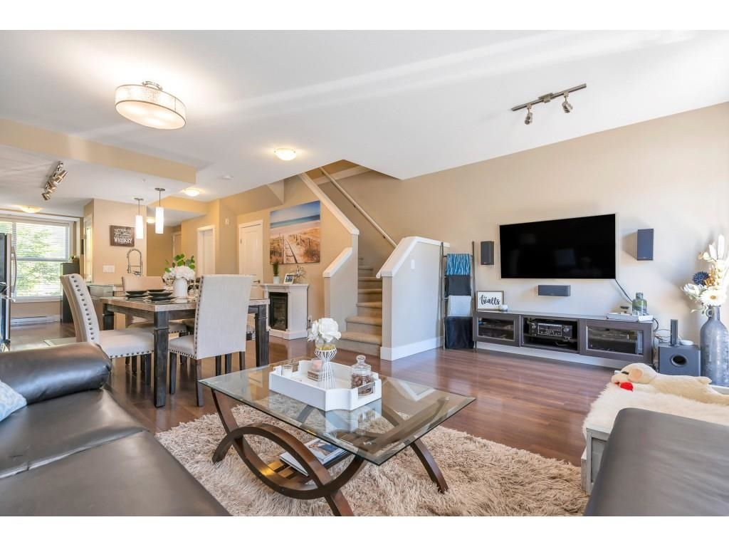 """Main Photo: 220 2110 ROWLAND Street in Port Coquitlam: Central Pt Coquitlam Townhouse for sale in """"AVIVA ON THE PARK"""" : MLS®# R2598714"""