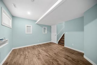 Photo 28: 5 Cougar Ridge Mews SW in Calgary: Cougar Ridge Row/Townhouse for sale : MLS®# A1105171