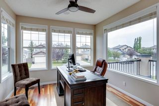 Photo 17: 63 Springbluff Boulevard SW in Calgary: Springbank Hill Detached for sale : MLS®# A1131940