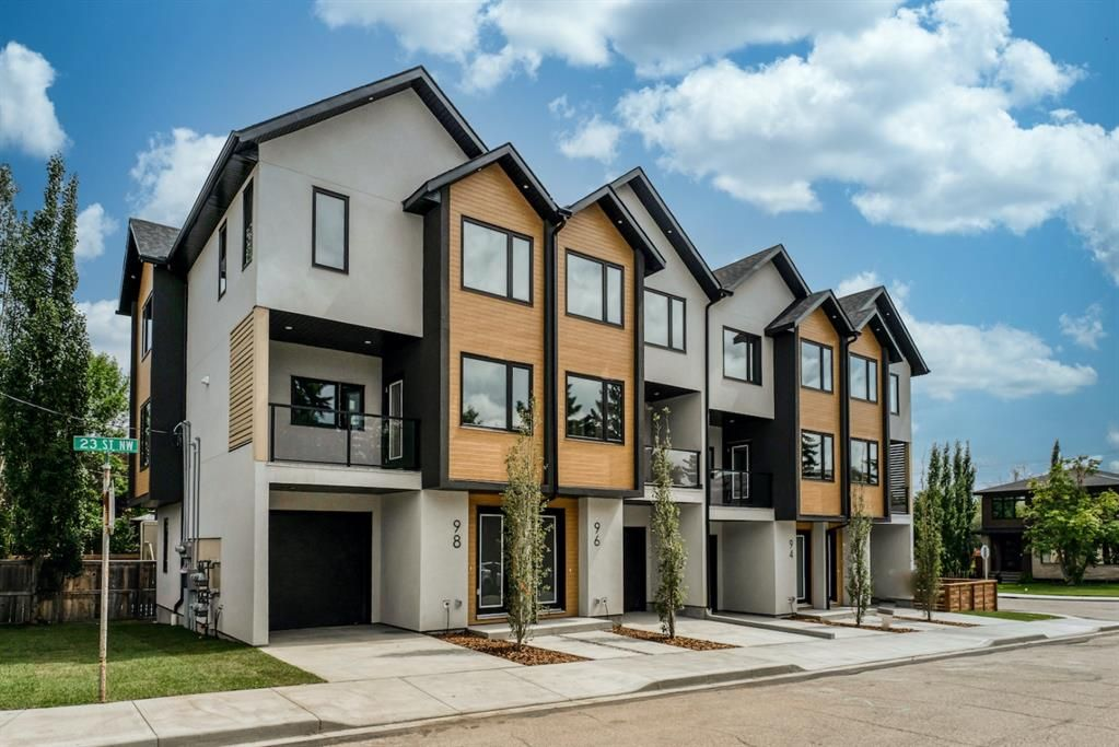 Main Photo: 98 23 Street NW in Calgary: West Hillhurst Row/Townhouse for sale : MLS®# A1066637