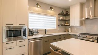Photo 11: 46 Wolf Creek Manor SE in Calgary: C-281 Detached for sale : MLS®# A1145612