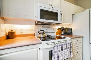 """Photo 17: 108 5475 201 Street in Langley: Langley City Condo for sale in """"HERITAGE PARK"""" : MLS®# R2539978"""