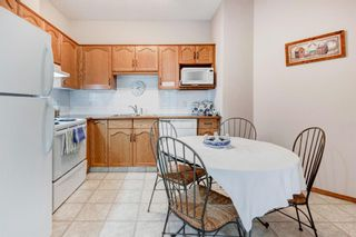 Photo 9: 111 72 Quigley Drive: Cochrane Apartment for sale : MLS®# A1137797