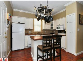 """Photo 3: 5723 148B Street in Surrey: Sullivan Station House for sale in """"Panorama Village"""" : MLS®# F1010272"""