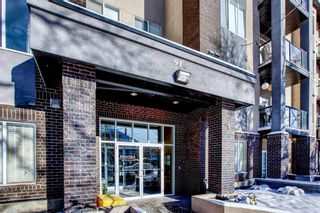 Photo 1: 408 910 18 Avenue SW in Calgary: Lower Mount Royal Apartment for sale : MLS®# A1039437