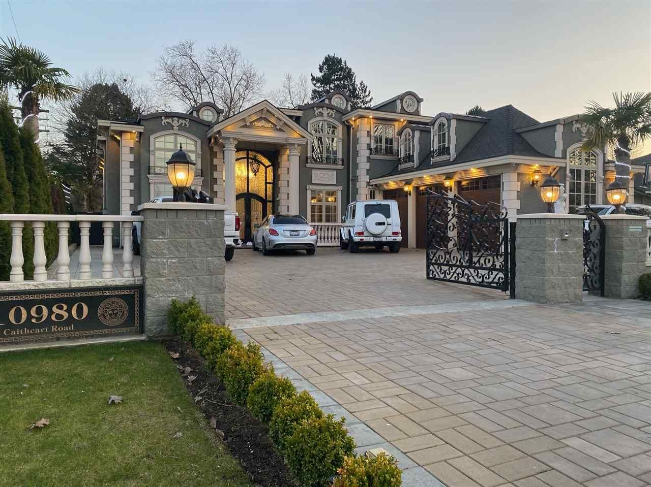 Exceptionally landscaped with extra large stone spindled fence, fountain in the front and back yard with lots of cedars for an extremely private setting.
