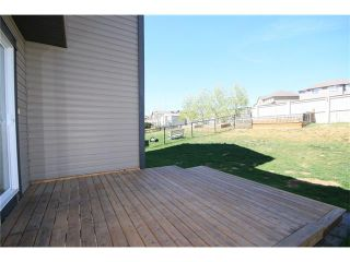 Photo 31: 81 SUNSET Heights: Cochrane House for sale : MLS®# C4072364