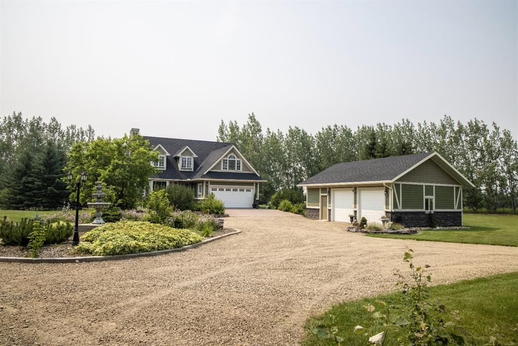 Main Photo: Private Treed Acreage in the City of Airdrie