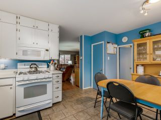 Photo 8: 4656 RAVINE Street in Vancouver: Collingwood VE House for sale (Vancouver East)  : MLS®# R2107811