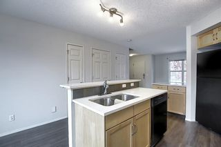 Photo 10: 157 Eversyde Boulevard SW in Calgary: Evergreen Semi Detached for sale : MLS®# A1055138