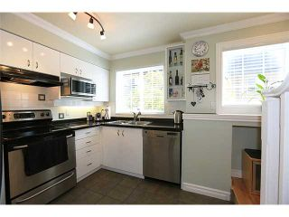 """Photo 4: 25 1561 BOOTH Avenue in Coquitlam: Maillardville Townhouse for sale in """"The Courcelles"""" : MLS®# V1026526"""