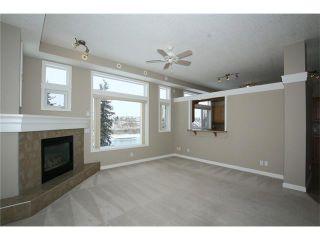 Photo 8: 191 CRAWFORD Drive: Cochrane Condo for sale : MLS®# C4103820