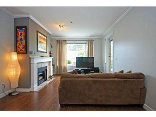 """Photo 3: 107 2340 HAWTHORNE Avenue in Port Coquitlam: Central Pt Coquitlam Condo for sale in """"BARRINGTON PLACE"""" : MLS®# V1097959"""