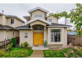 Photo 2: 380 STRATFORD Avenue in Burnaby: Capitol Hill BN 1/2 Duplex for sale (Burnaby North)  : MLS®# R2411548