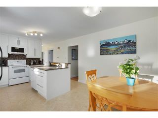 Photo 10: 803 104 Avenue SW in Calgary: Southwood House for sale : MLS®# C4092868