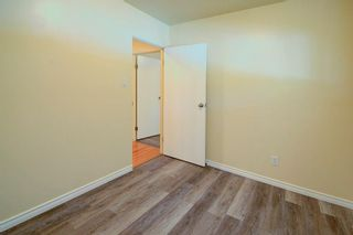 Photo 14: 50 FRASER Road SE in Calgary: Fairview Detached for sale : MLS®# A1145619